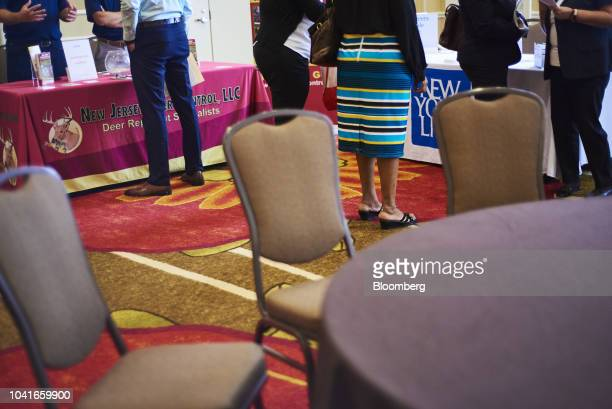 Job seekers speak with representatives during a National Career Fair event in Edison New Jersey US on Thursday Sept 20 2018 Filings for US...