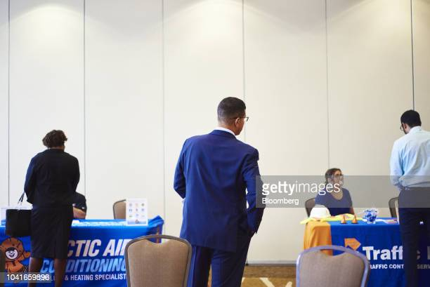 Job seekers speaks with representatives during a National Career Fair event in Edison New Jersey US on Thursday Sept 20 2018 Filings for US...