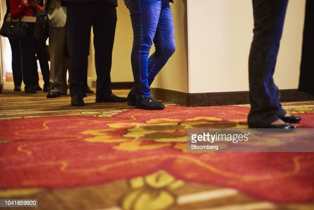 Job seekers stand in line to enter a National Career Fair event in Edison New Jersey US on Thursday Sept 20 2018 Filings for US unemployment benefits...