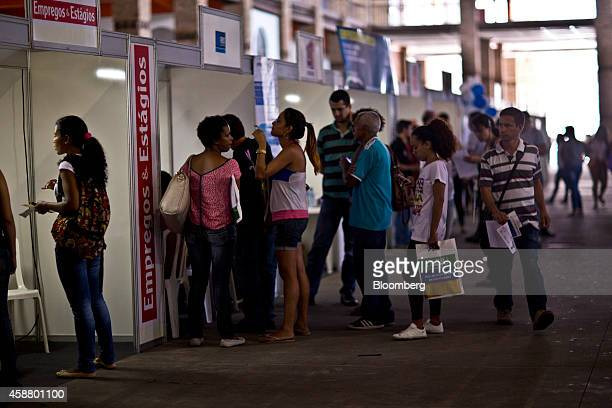 Job seekers wait in line at a job fair promoted by the mayor's office to boost employment in the port area currently under renovation in Rio de...