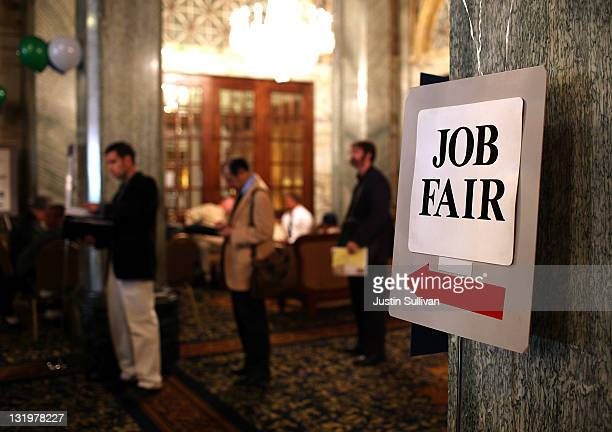Job seekers wait in line to enter the San Francisco Hire Event job fair on November 9 2011 in San Francisco California The national unemployment rate...