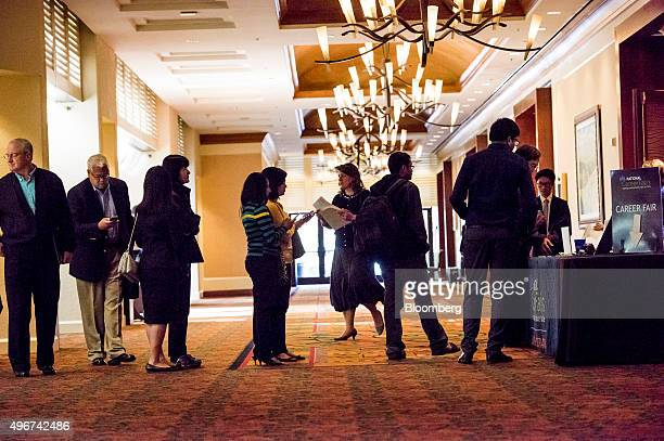 Job seekers wait in line to enter the San Jose Career Fair in San Jose California US on Tuesday Nov 10 2015 The US Department of Labor is scheduled...