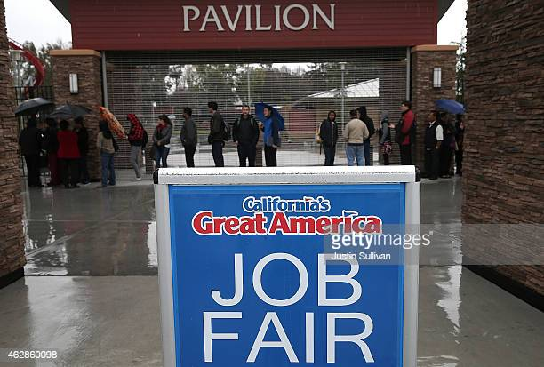 Job seekers wait in line to register for a job fair at California's Great America theme park on February 6 2015 in Santa Clara California Hundreds of...