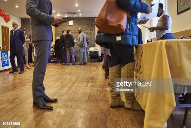 Job seekers wait in line to speak with a representative during a Shades of Commerce Career Fair in the Brooklyn borough of New York US on Saturday...