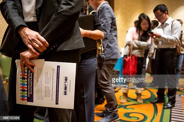 Job seekers wait in line to speak with recruiters during the San Jose Career Fair in San Jose California US on Tuesday Nov 10 2015 The US Department...