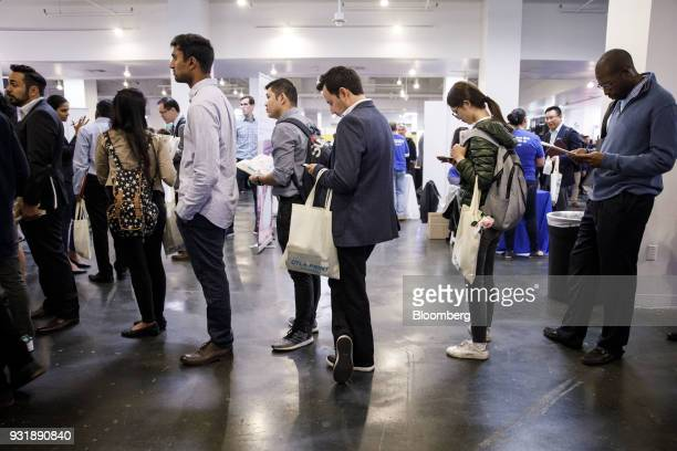 Job seekers wait in line to speak with representative during the TechFair LA career fair in Los Angeles, California, U.S., on Thursday, March 8,...