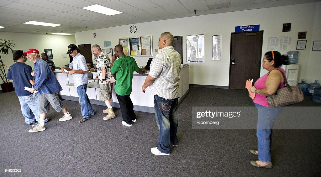Job seekers wait to sign-in inside the Riverside Workforce