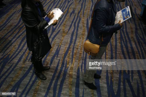 Job seekers wait to speak with recruiters during a Job News USA career fair in Overland Park Kansas US on Wednesday March 8 2017 Applications for US...
