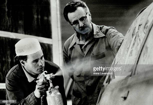 Job training Harry Spencer right manager of the Salvation Army Community Autobody Shop watches Ken Hansen 25 spray paint a car The shop trains...