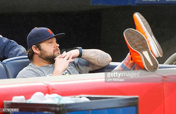 Joba Chamberlain of the Detroit Tigers a former New York Yankee watches Old Timer's Day ceremonies before their game at Yankee Stadium on June 20...