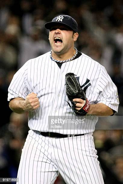Joba Chamberlain of the New York Yankees celebrates striking out Vladimir Guerrero of the Los Angeles Angels of Anaheim to end the top of the seventh...