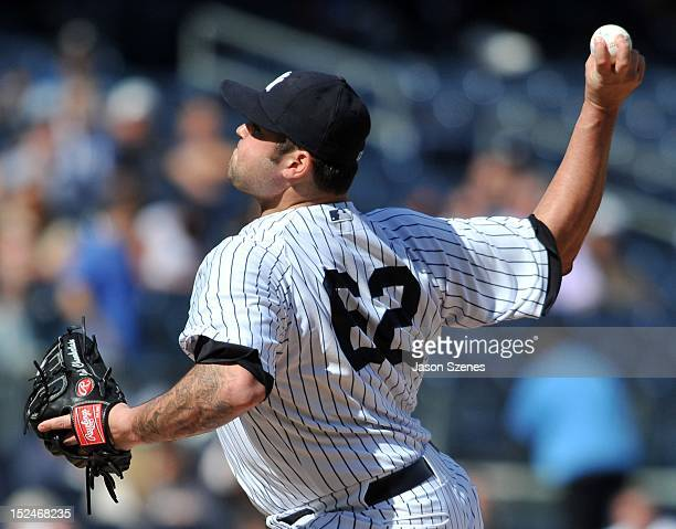 Joba Chamberlain of the New York Yankees pitches against the Toronto Blue Jays in the first game of a doubleheader at Yankee Stadium on September 19...
