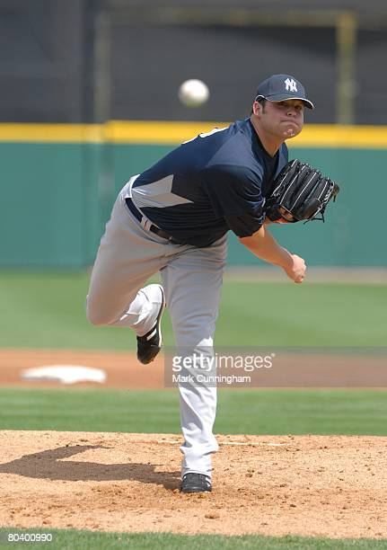 Joba Chamberlain of the New York Yankees pitches during the spring training game against the Detroit Tigers at Joker Marchant Stadium in Lakeland...