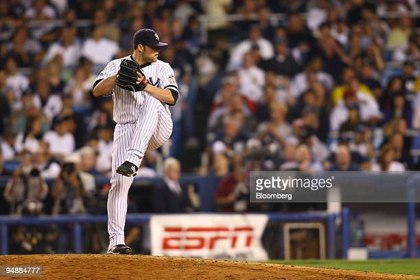Joba Chamberlain pitcher for the New York Yankees pitches against the Baltimore Orioles during the final game at Yankee Stadium in the Bronx borough...