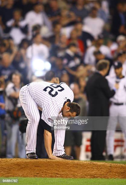 Joba Chamberlain pitcher for the New York Yankees touches the pitcher's mound after the final game at Yankee Stadium in the Bronx borough of New York...