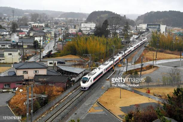 Joban Line express train 'Hitachi heads toward Sendai when full service was restored on March 14, 2020 in Futaba, Fukushima, Japan. A 21-kilometer...