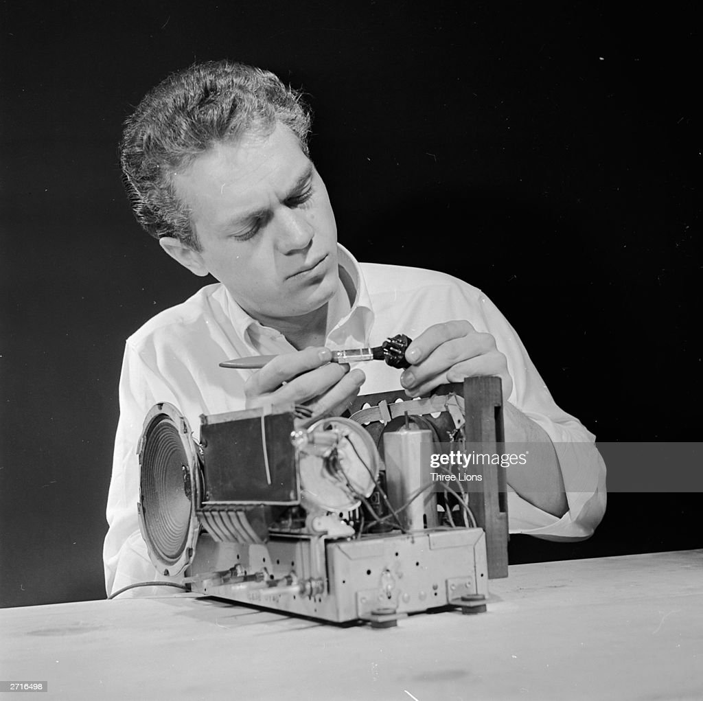 A jobbing Steve McQueen demonstrates how to repair a broken radio.