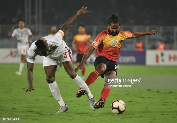 Jobby Justin of East Bengal tries to go past Mohun Bagan defender Eze during the I-League Match, at Salt Lake Stadium, on December 16, 2018 in...
