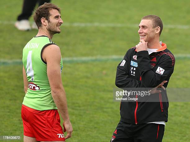 Jobe Watson and interim senior coach Simon Goodwin react during an Essendon Bombers training session at Windy Hill on August 30 2013 in Melbourne...