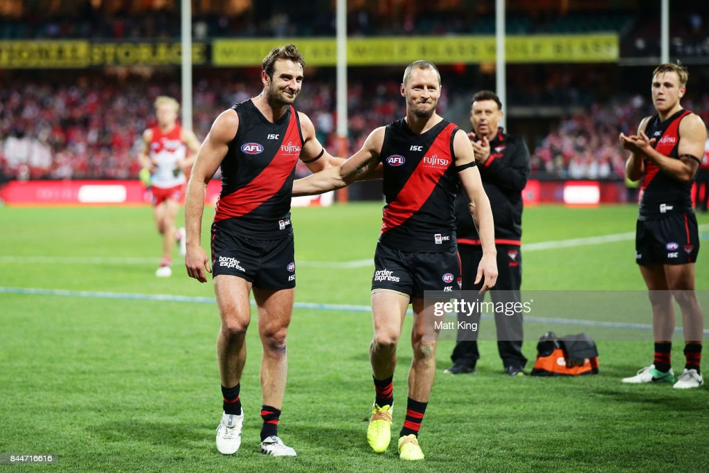 Jobe Watson (L) and James Kelly (R) of the Bombers leave the field after playing their last AFL match during the AFL Second Elimination Final match between the Sydney Swans and the Essendon Bombers at Sydney Cricket Ground on September 9, 2017 in Sydney, Australia.