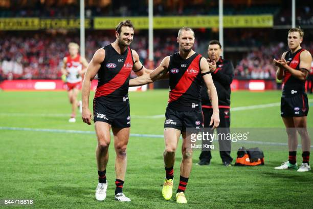 Jobe Watson and James Kelly of the Bombers leave the field after playing their last AFL match during the AFL Second Elimination Final match between...