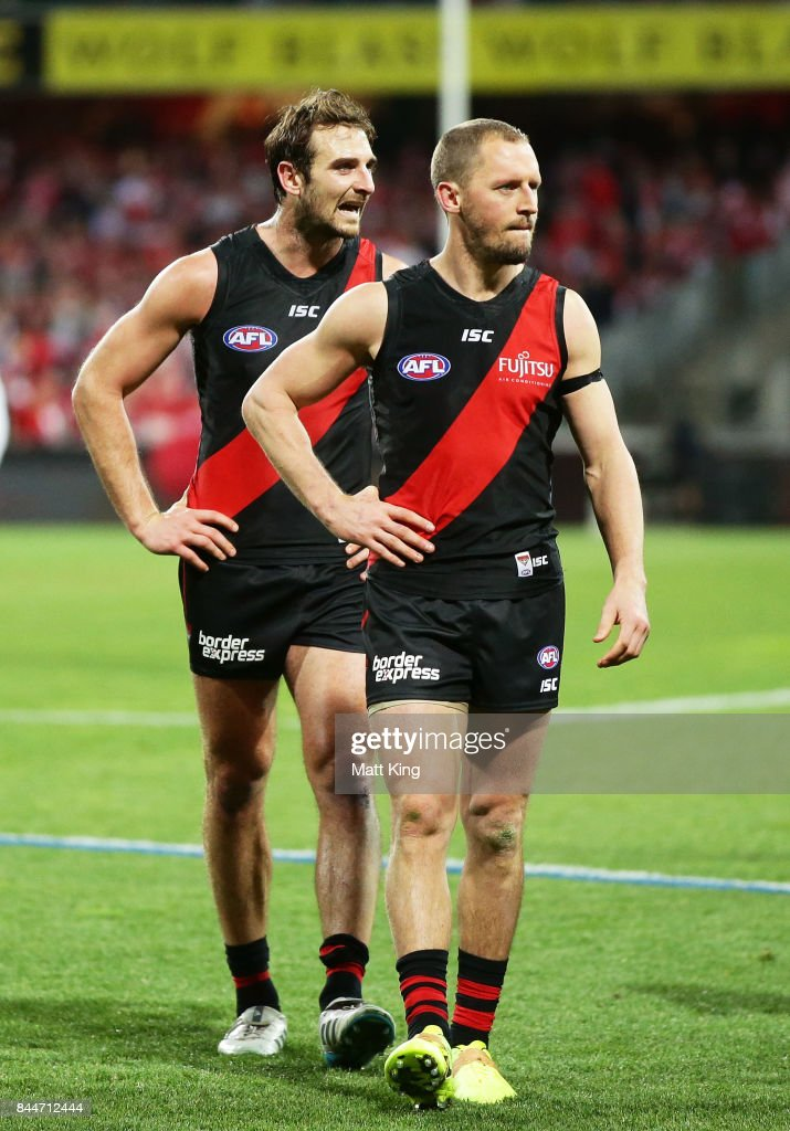 Jobe Watson (L) and James Kelly (R) of the Bombers looks dejected as they leave the field after playing their last AFL match during the AFL Second Elimination Final match between the Sydney Swans and the Essendon Bombers at Sydney Cricket Ground on September 9, 2017 in Sydney, Australia.