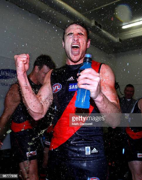 Jobe Watson Captain of the Bombers is sprayed with sportsdrink as they sing the team song after their win in the round 6 AFL match between the...