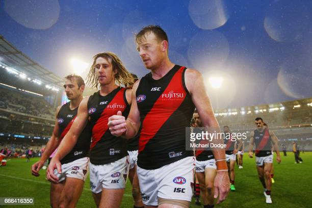 Jobe Watson Dyson Heppell and Brendon Goddard of the Bombers looks dejected after defeat during the round three AFL match between the Carlton Blues...