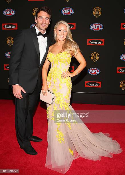 Jobe Watson of the Bombers and his partner Ella Keddie arrive ahead of the 2013 Brownlow Medal at Crown Palladium on September 23 2013 in Melbourne...