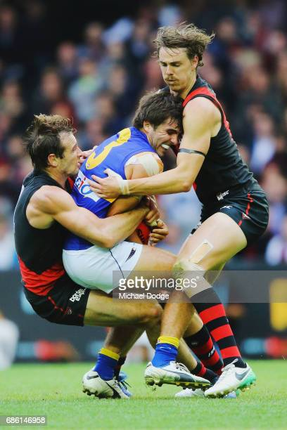 Jobe Watson of the Bombers and Joe Daniher tackles Andrew Gaff of the Eagles during the round nine AFL match between the Essendon Bombers and the...