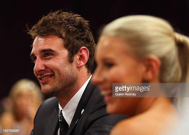 Jobe Watson of the Bombers and partner Ella Keddie watch on during the 2012 Brownlow Medal at Crown Palladium on September 24 2012 in Melbourne...