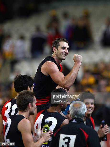 Jobe Watson of the Bombers celebrates while being chaired off after his 100th match after the round six AFL match between the Essendon Bombers and...