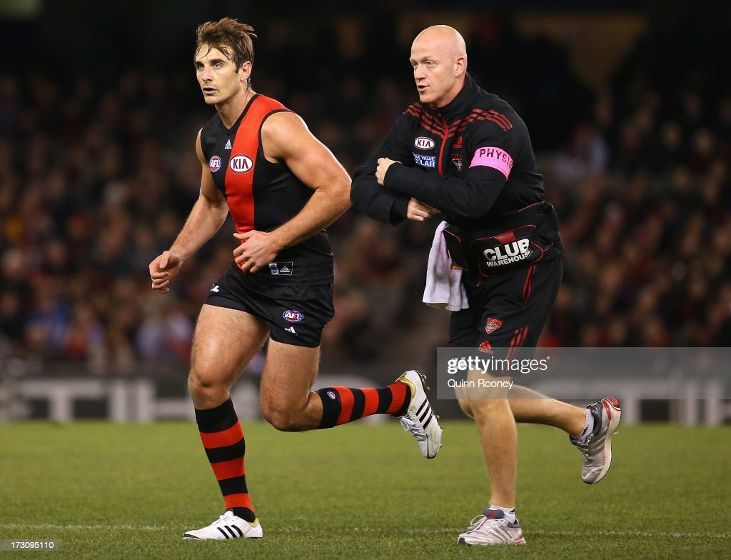Jobe Watson of the Bombers comes from the ground after a bump from Justin Westhoff of the Power during the round 15 AFL match between the Essendon Bombers and Port Adelaide Power at Etihad Stadium on July 7, 2013 in Melbourne, Australia.
