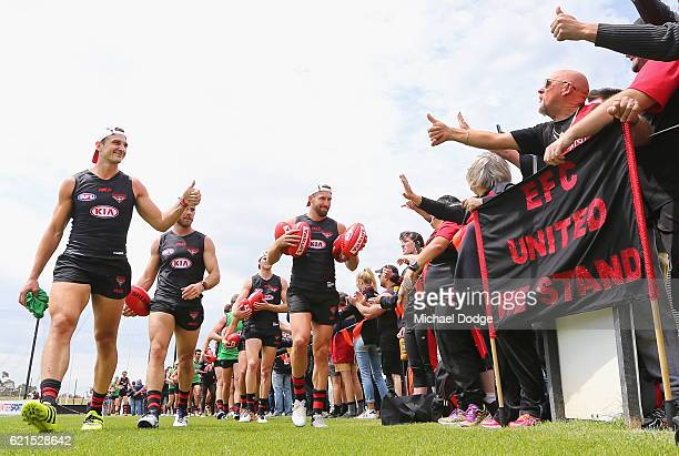 Jobe Watson of the Bombers gestures to fans during an Essendon Bomber AFL preseason training session at True Value Solar Centre on November 7 2016 in...