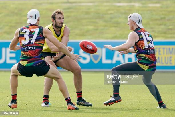 Jobe Watson of the Bombers handballs during an Essendon Bombers AFL training session at True Value Solar Centre on May 18 2017 in Melbourne Australia
