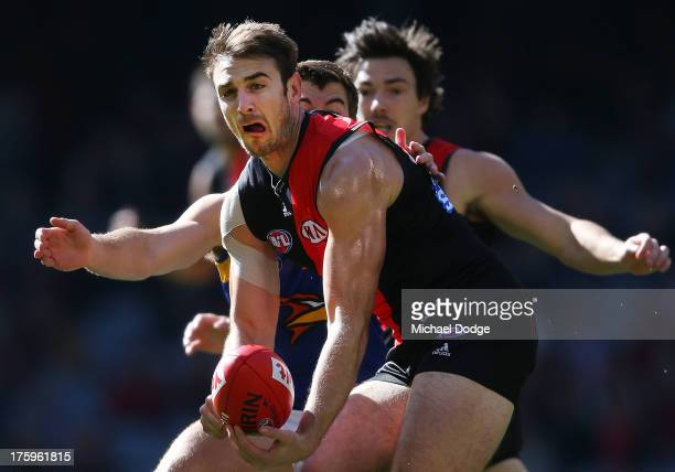 Jobe Watson of the Bombers handpasses the ball during the round 20 AFL match between the Essendon Bombers and the West Coast Eagles at Etihad Stadium...