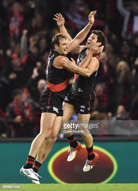 Jobe Watson of the Bombers is congratulated by Ben Howlett after kicking a goal during the round 21 AFL match between the Essendon Bombers and the...