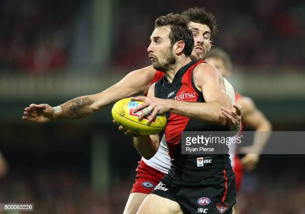 Jobe Watson of the Bombers is tackled by Sam Naismith of the Swans during the round 14 AFL match between the Sydney Swans and the Essendon Bombers at...