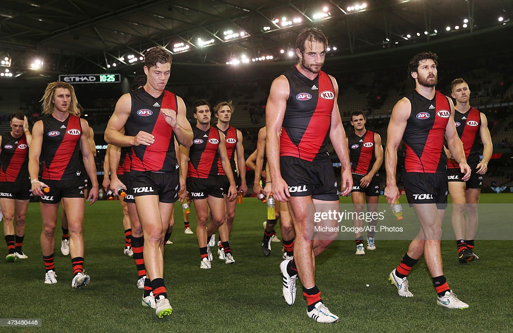 Jobe Watson of the Bombers leads the team off after defeat during the round seven AFL match between the Essendon Bombers and the North Melbourne Kangaroos at Etihad Stadium on May 15, 2015 in Melbourne, Australia.