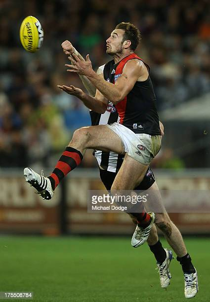 Jobe Watson of the Bombers marks the ball against Tyson Goldsack of the Magpies during the round 19 AFL match between the Collingwood Magpies and the...