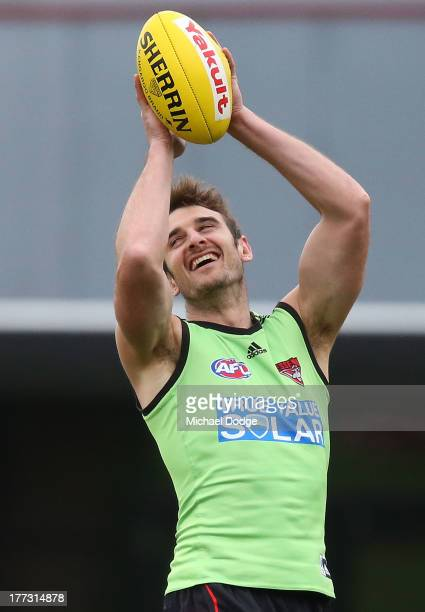 Jobe Watson reacts during an Essendon Bombers AFL training session at Windy Hill on August 23 2013 in Melbourne Australia