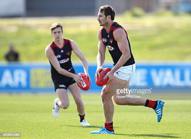 Jobe Watson runs with the ball during an Essendon Bombers AFL training session at True Value Solar Centre on August 22 2014 in Melbourne Australia