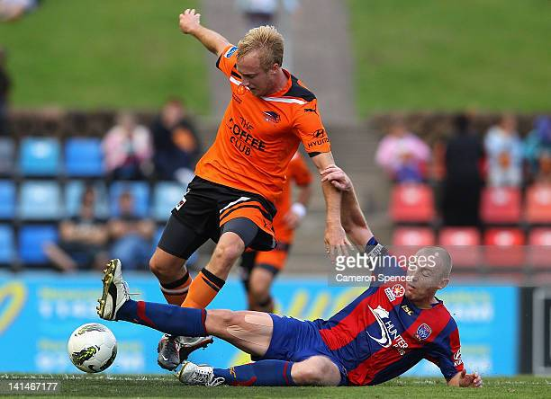 Jobe Wheelhouse of the Jets tackles Mitchell Nichols of the Roar during the round 24 ALeague match between the Newcastle Jets and the Brisbane Roar...