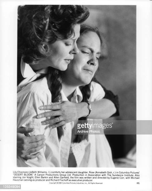 JoBeth Williams holding Annabeth Gish in a scene from the film 'Desert Bloom' 1985