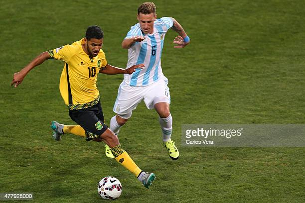 Jobi McAnuff of Jamaica fights for the ball with Lucas Biglia of Argentina during the 2015 Copa America Chile Group B match between Argentina and...