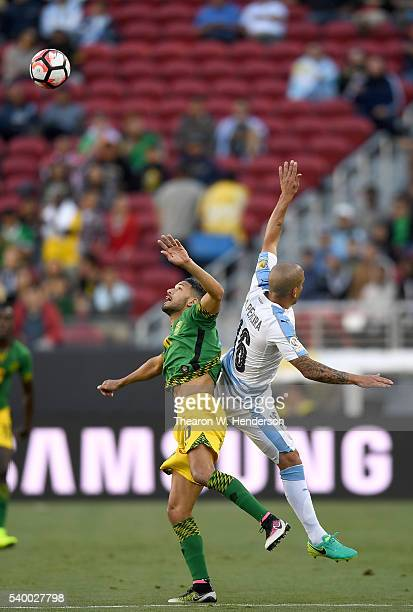 Jobi McAnuff of Jamaica hits a header ad collides with Maximiliano Pereira of Uruguay during the 2016 Copa America Centenario Group match play...