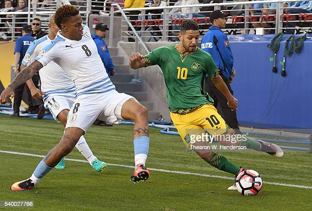 Jobi McAnuff of Jamaica looks to shoot the ball past Abel Hernandez of Uruguay during the 2016 Copa America Centenario Group match play between...