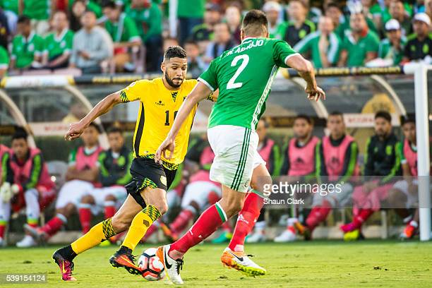 Jobi McAnuff of Jamaica takes on Nestor Araujo of Mexico during the Copa America Centenario Group C match between Mexico and Jamaica at the Rose Bowl...