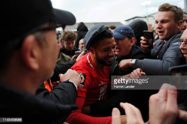 Jobi McAnuff of Leyton Orient celebrates with fans as they win the title after the Vanarama National League match between Leyton Orient and Braintree...