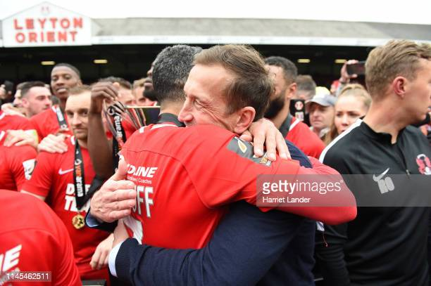 Jobi McAnuff of Leyton Orient celebrates with Justin Edinburgh manager of Leyton Orient as they win the title after the Vanarama National League...